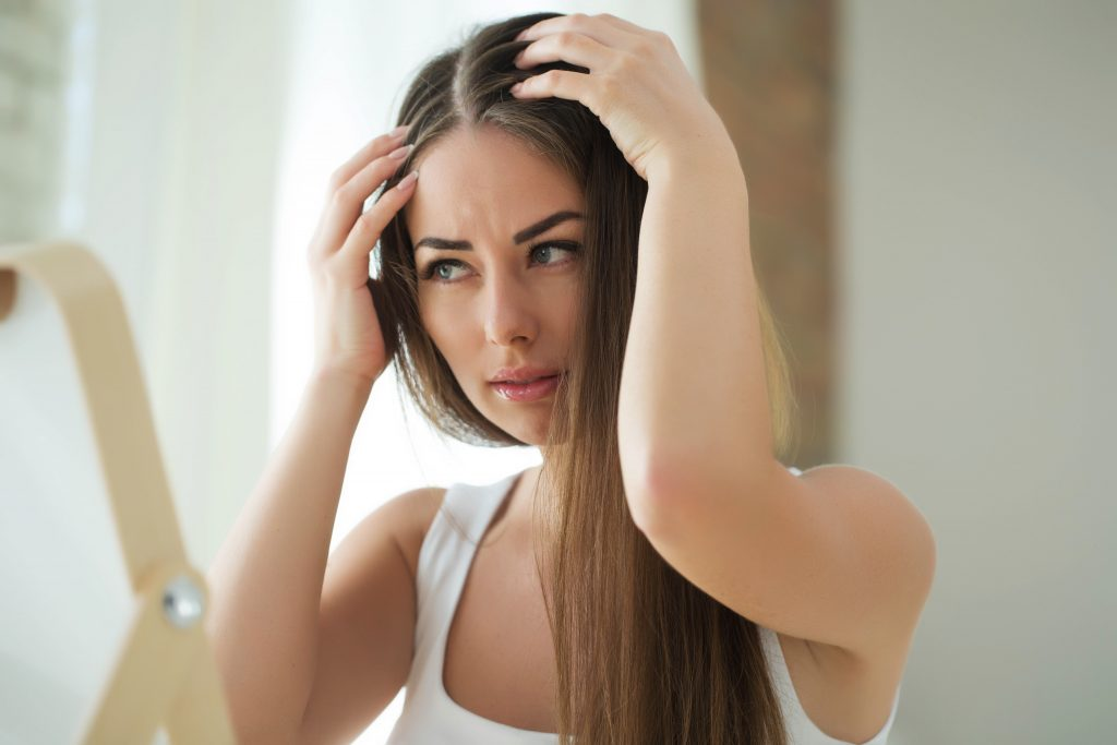 woman checking for hair loss